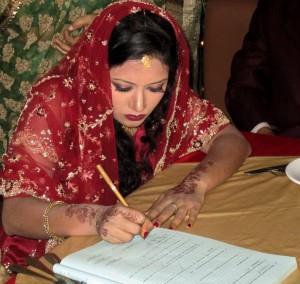 Unterschrift unter die Heiratsurkunde.