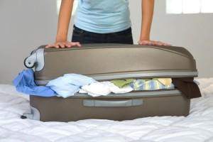 Wenn der Koffer nicht zugeht, war die Packliste definitiv zu lang. Foto: ©Jupiterimages/Photos.com/Thinkstock