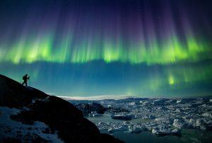 Nordlichter am Ilulissat Fjord - ein echtes Grönland-Erlebnis. Foto: Paul Zizka / www.greenland-travel.de/
